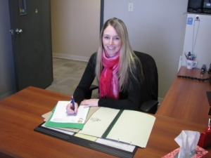 John Howard Society volunteer completes paperwork for probation officer